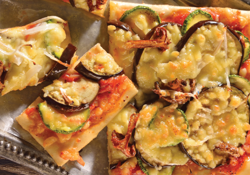 Vegetarian pizza with zucchini and mushrooms